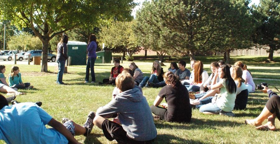 International Club members gather at the annual opening picnic to discuss plans for this year at Centennial Park.