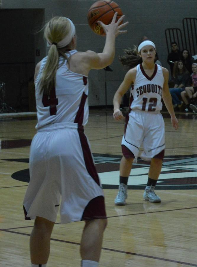 The Sequoits are off to a 1-0 start to the season. Sophomore Ashley Reiser passes the ball to junior Alexis Duehr.