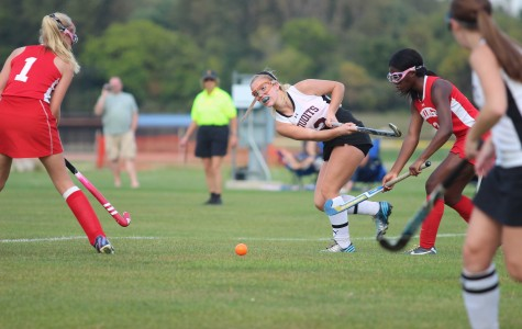 ACHS Junior Natalie Nielsen drives the ball up the field.