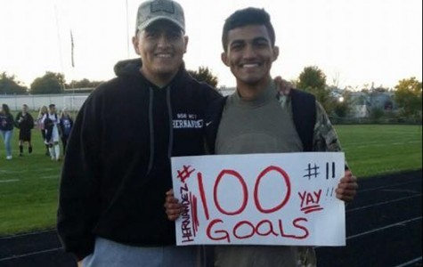 ACHS senior Iven Hernandez with his brother, Andy, after scoring his 100th goal for the boys Varsity soccer team on Oct. 9 against Zion-Benton.