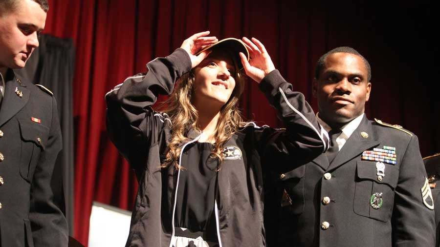 ACHS senior Morgan Yankee accepts a U.S. Army All American Marching Band jacket and hat.