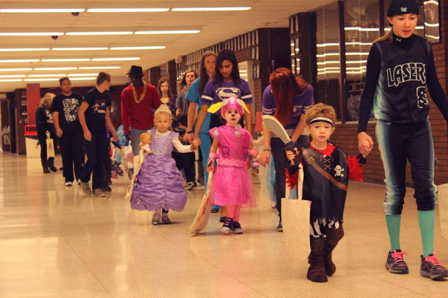 Pre-Schoolers trick o treating the halls of ACHS