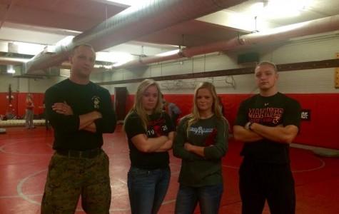 Marine Jason Moxley, senior Natalie Ivins, junior Natalie Nielsen and Marine Tommy Langbein posing after self defense training.