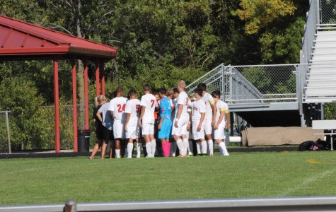 The ACHS boys varsity soccer team huddles up before a game.