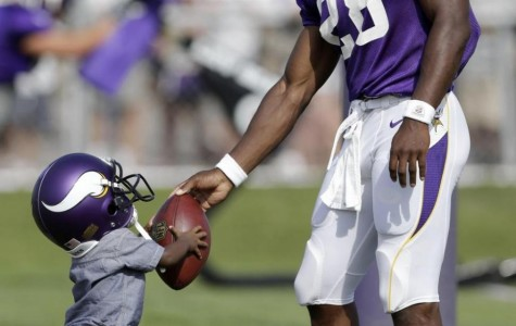 Adrian Peterson Shares a Moment With His Son