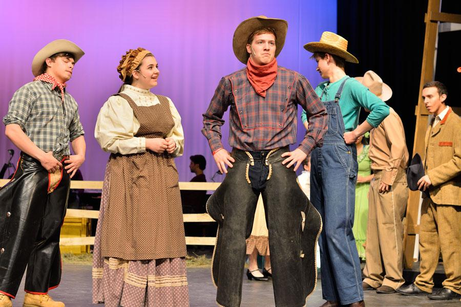 Senior Alex Fink, alumna Avery Herbon, alumnus Zac Keller and senior Riley Beckett take the stage for ACHS 2014 production of Oklahoma! The musical is on of many successful productions by ACHS students.