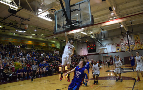 Junior Kyle Gofron going for a lay up against lakes defender.