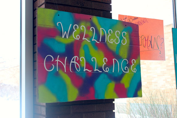 Students promote the Sequoit Wellness Challenge by hanging posters in the commons