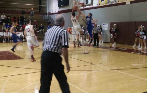 Weston Fox going up for a basket against the Vernon Hills Cougars
