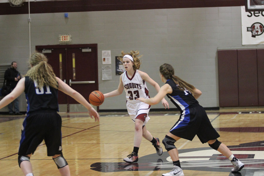 Junior Kelly Johnson drives down the court.