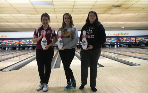 Girls Bowling Looks on After Tough Loss