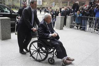 Dennis Hastert in wheelchair arriving in Chicago for sentencing.
