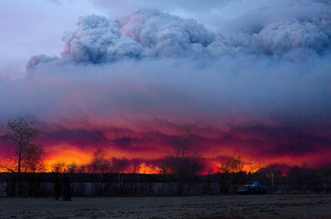 Wildfires sweep across Canada and approach Fort McMurray, Alberta.
