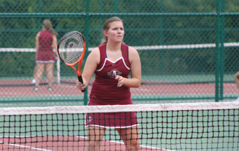Taylor Horner prepares to hit a tennis ball.