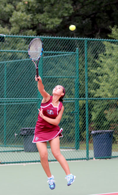 Returning+state+qualifier%2C+Sjana+Henderson+%2812%29%2C+rallies+the+ball+back+to+her+opponent+in+her+match+soundly+Thursday+night.+The+Sequoits+beat+Lakes+6-1.+Caption+by+Jill+Foote