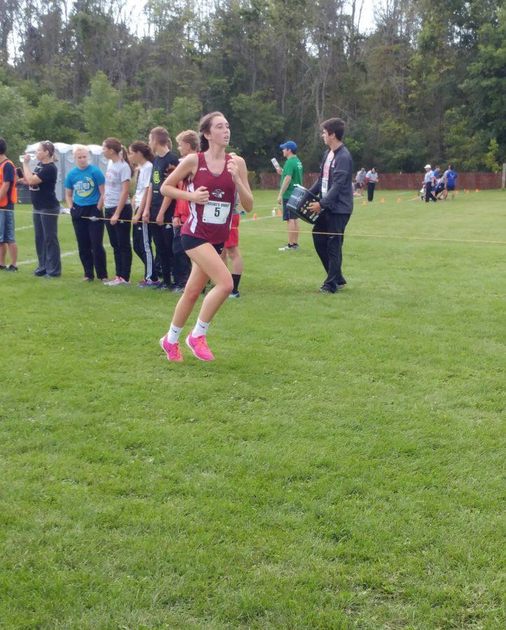 Senior Hailey Hall running in the girls cross countrys first meet of the season