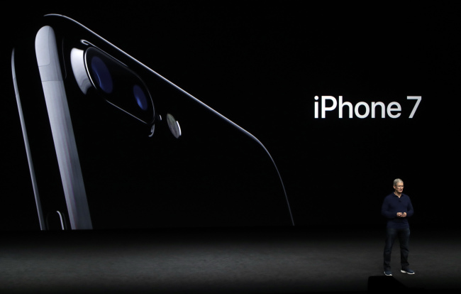 Apple CEO Tim Cook announces the iPhone 7 on Wednesday.