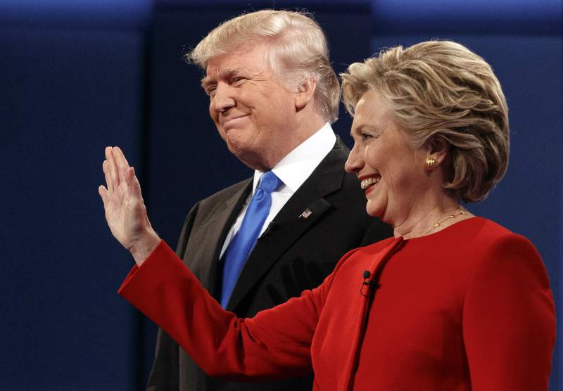 Donald Trump stands with Hillary Clinton at Mondays presidential debate at Hofstra University in Hempstead, New York.
