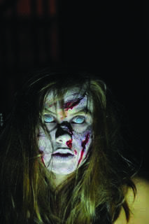 """The makeup applied on the model is a recreation of the main character, Regan, from """"The Exorcist.""""  """"I thought  'The Exorcist' was very creepy and I was scared of getting nightmares,"""" freshman Jadda Pope said."""