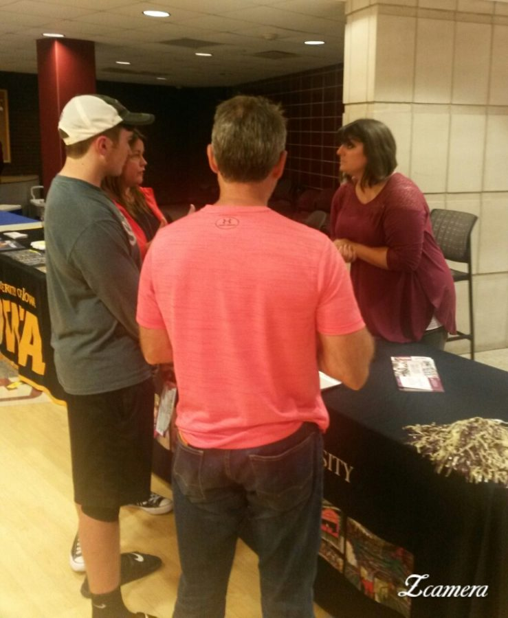 College representatives from various universities  talked to students and parents during College Planning Night.