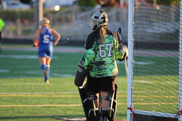 Senior Rebekah Cartlidge defends against Lakes.