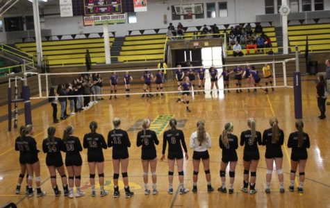 The girls volleyball team stands for the introductions of both teams before their match at Waukegan.