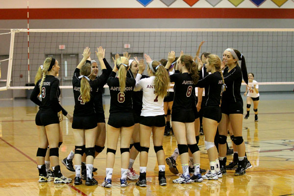 Sequoit volleyball girls celebrate their win as their season comes to an end.
