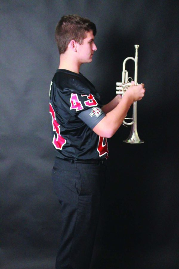 """Sophomore Patrick Beake plays both the trumpet and football, which gives a little insight to what his life is like after school. """"It is a lot of work, both physically and mentally,"""" Beake said. """"I have to learn formations for football and marching band and when you throw in fatigue, it becomes very hard."""""""