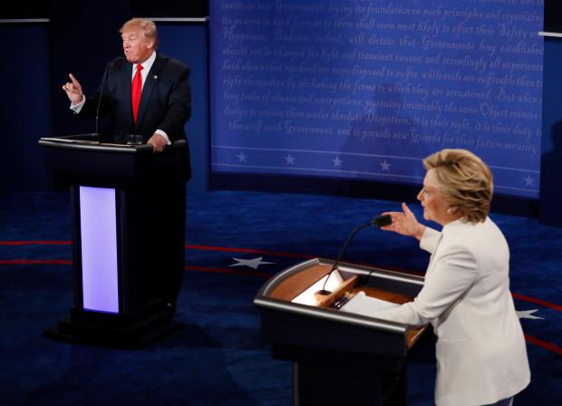 Democratic presidential nominee Hillary Clinton and Republican presidential nominee Donald Trump debate during the third presidential debate at UNLV in Las Vegas, Wednesday, October 19, 2016.