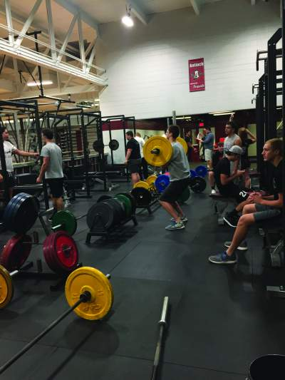 Coach Jordan Eder's Zero Hour Physical Best class lifts earlier this morning.