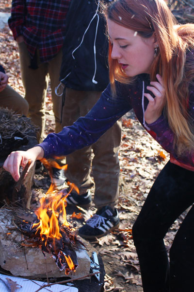 By learning the basics by starting a fire in Adventure Ed, junior Rachel Jameson participates in the adventure. The class learned simple situations that could be used in difficult situations. Caption by Noor Abdeliatif & RaeAnn Leist