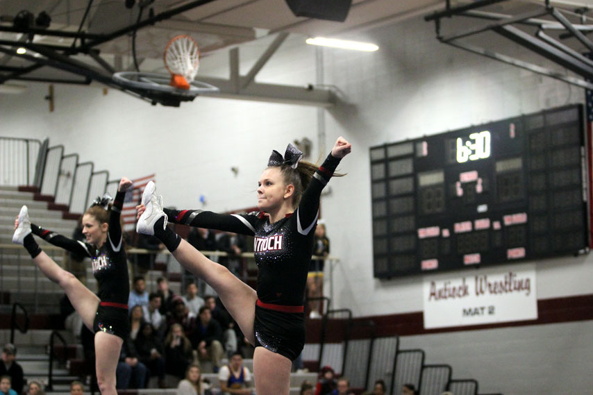 Senior Desiree Davis goes up in a stunt at the cheers Martin Luther King Jr. competition in cheers new uniforms.