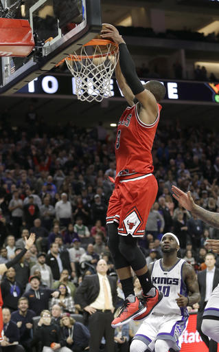 Chicago Bulls guard Dwyane Wade, left, dunks over Sacramento Kings guard Ty Lawson right, after stealing an inbound pass during the closing moments of an NBA basketball game Monday, Feb. 6, 2017, in Sacramento, Calif. The Bulls won 112-107. (AP Photo/Rich Pedroncelli)