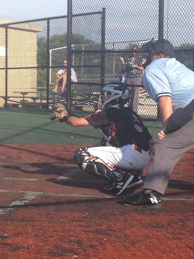 Junior Colin Wieska plays catcher for his team in a summer tournament.