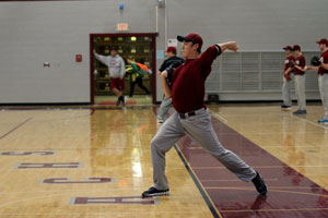 Senior Timothy Otter practices his throws this week at baseball tryouts, which were held from February 28 to March 2.