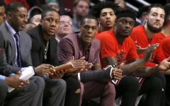 With a cast on his right thumb, Chicago Bulls' Rajon Rondo, center sits on the bench during the first quarter in Game 3 of the team's NBA basketball first-round playoff series against the Boston Celtics in Chicago, Friday, April 21, 2017. (AP Photo/Charles Rex Arbogast)