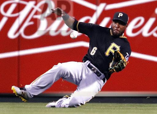 Pittsburgh Pirates center fielder Starling Marte slides to catch a line drive by St. Louis Cardinals' Dexter Fowler to end the eighth inning of a baseball game Monday, April 17, 2017, in St. Louis. (AP Photo/Jeff Roberson)