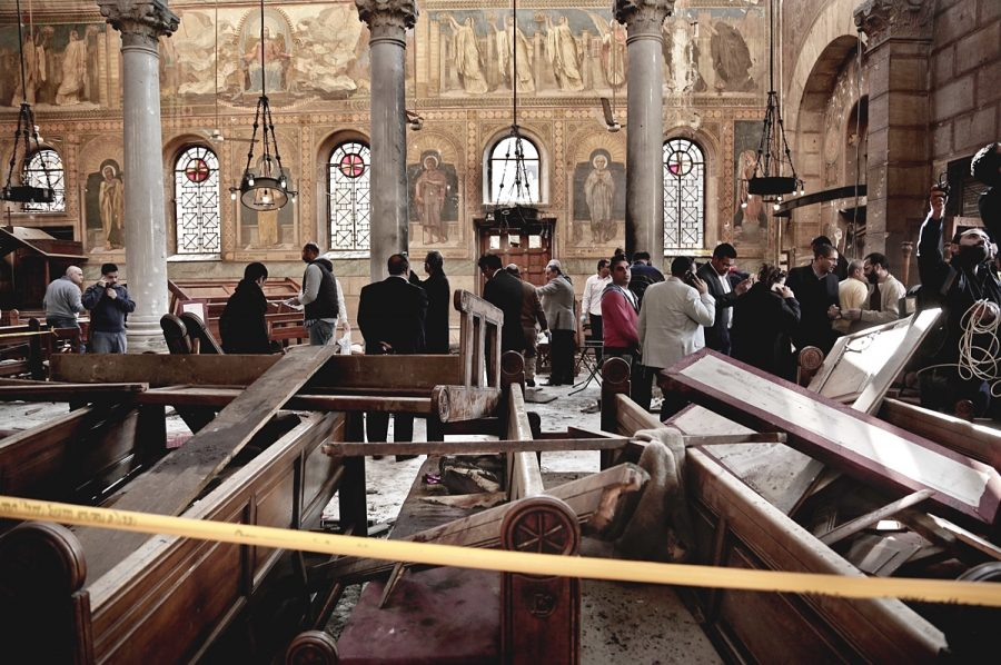 Security+forces+examine+the+scene+inside+the+St.+Mark+Cathedral+in+central+Cairo%2C+following+a+bombing+that+killed+dozens+of+people.+A+20-minute+video+from+an+Islamic+State+affiliate+in+Egypt+showed+the+suicide+bomber+who+attacked+the+church+and+who+vowed+more+attacks+on+the+country%27s+Christian+minority.+The+video+said+Christians+are+the+extremist+group%27s+%22favorite+prey.%22+