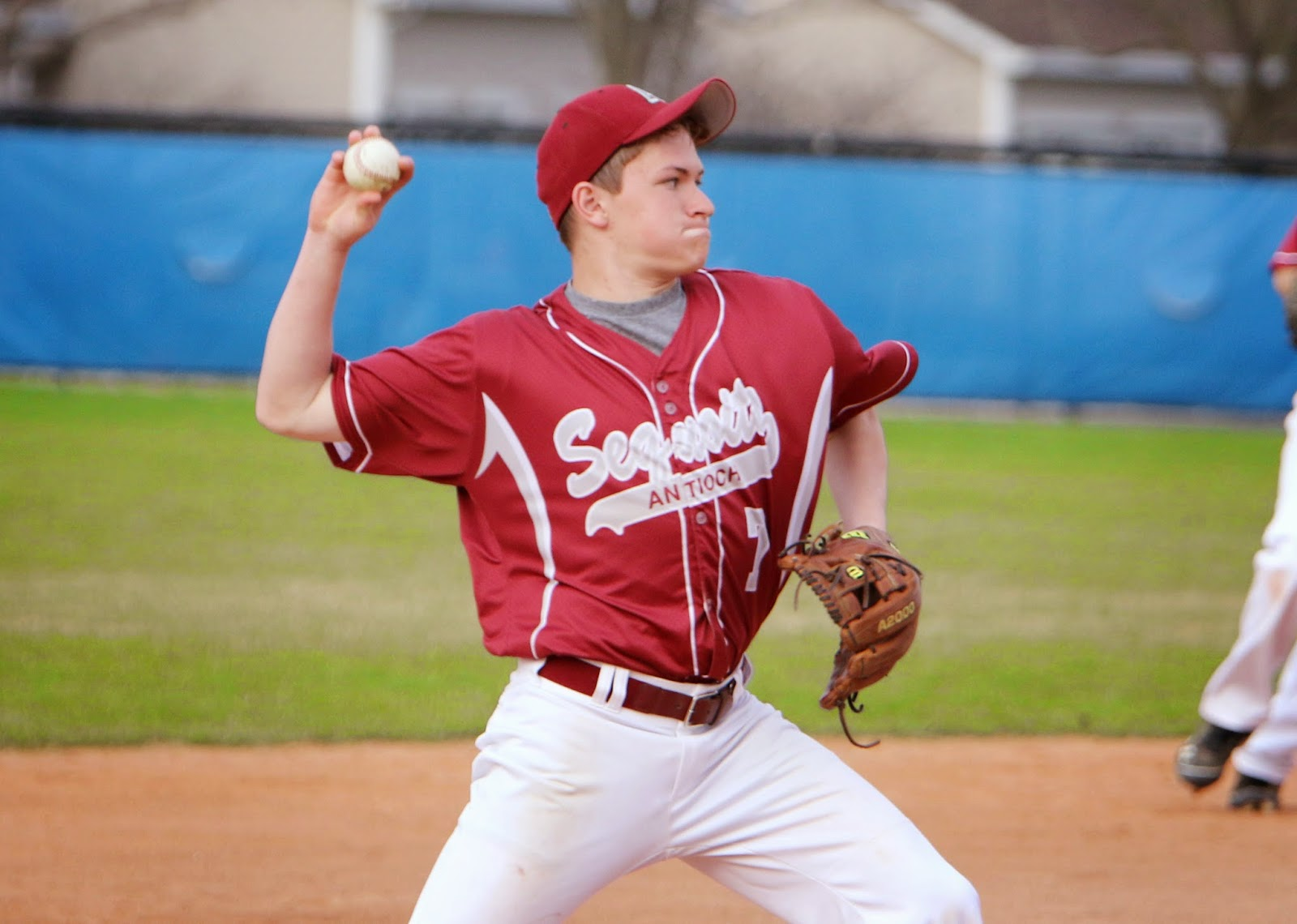 Senior Conner Geidner plays the ball and throws it to first looking for an out.