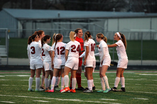 Junior and Captain Monica Wilhelm breaks out the team at the beginning of their game on April 11.