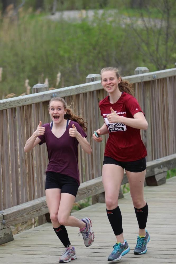 Seniors Miranda Morrow and Elisa Pokorny start off the race full of smiles.