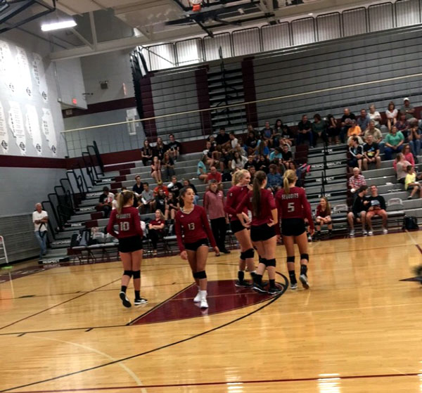 Varsity girls volleyball starting their game against Woodlands Academy on August 29th.