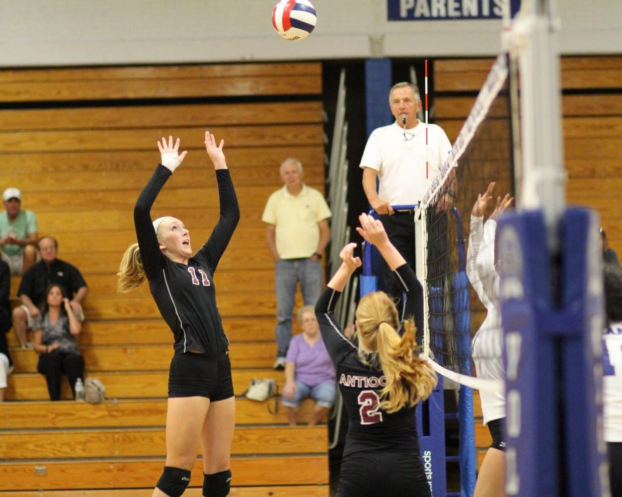 Seniors Katherine Barr and Kennedy Moll move the ball through the front row to get a kill on offense.