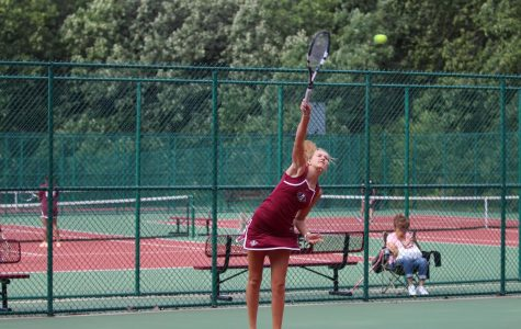Kelsey Neville serves during her match against Zion-Benton on Wednesday, August 30.
