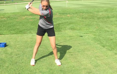 Samantha Brown warms up her swing before beginning the 18 holes.