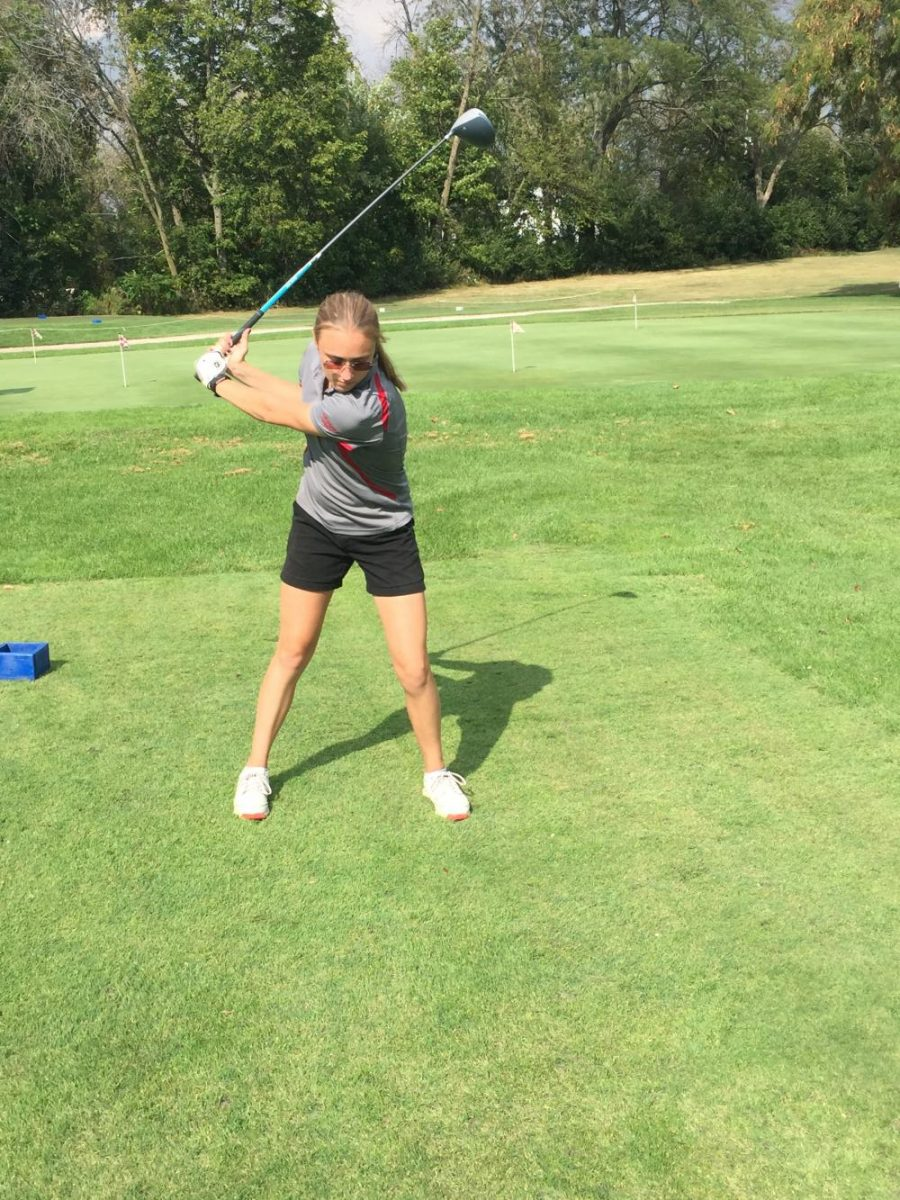 Samantha+Brown+warms+up+her+swing+before+beginning+the+18+holes.