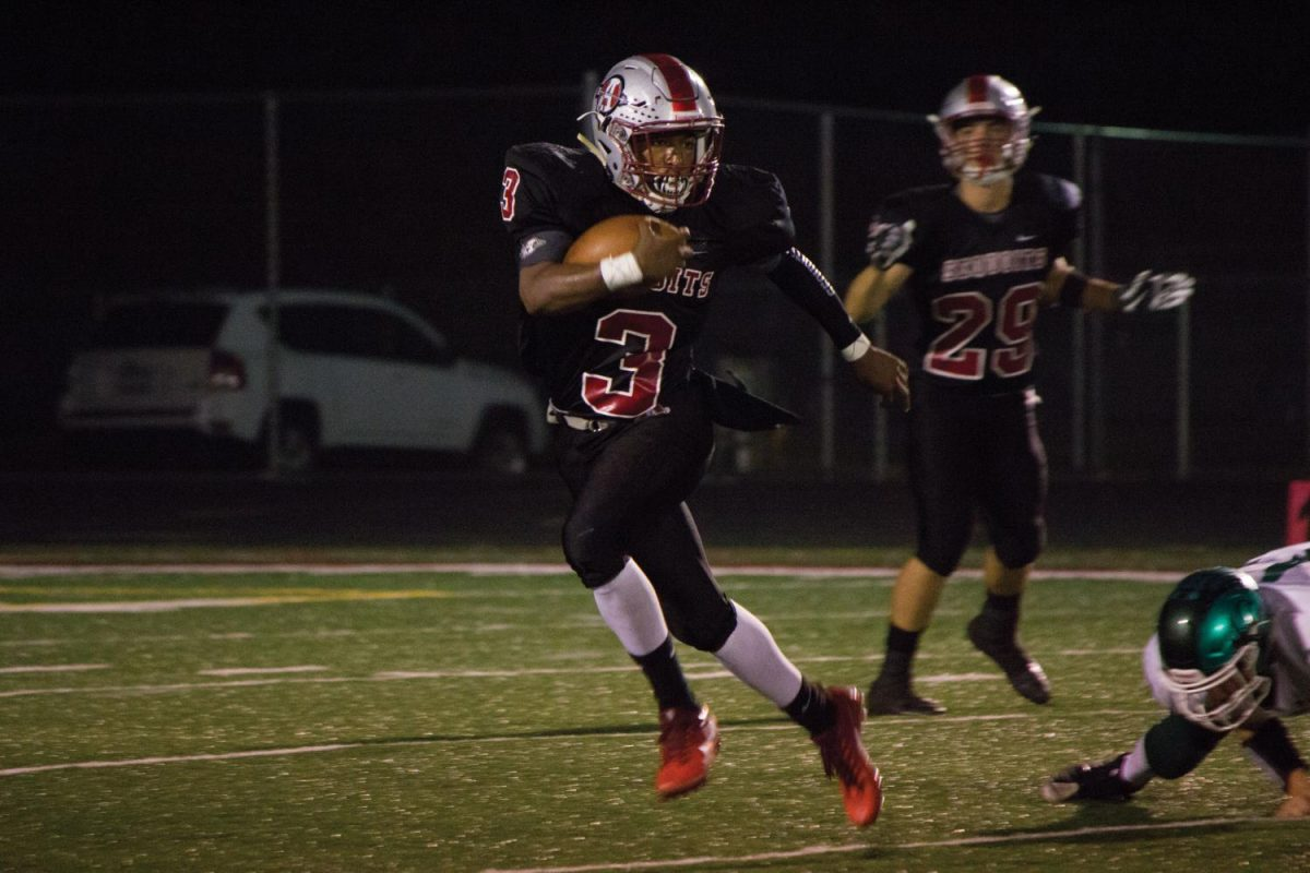 Senior Drew Porter catches and runs the ball during the second half of Friday night's game.