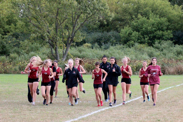 Girls cross country getting their stretches in before their race.