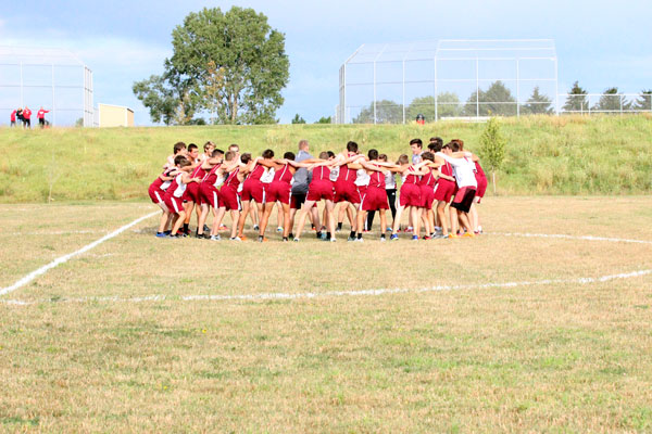 Boys Cross Country get pumped up for their meet against Grant and Grayslake Central