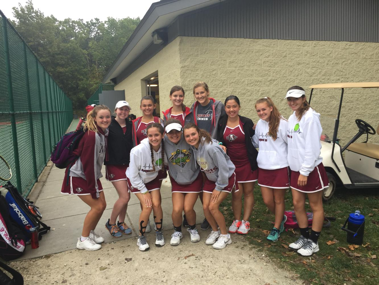 The girls varsity tennis team is excited to continue their matches on Saturday despite the oncoming rain.
